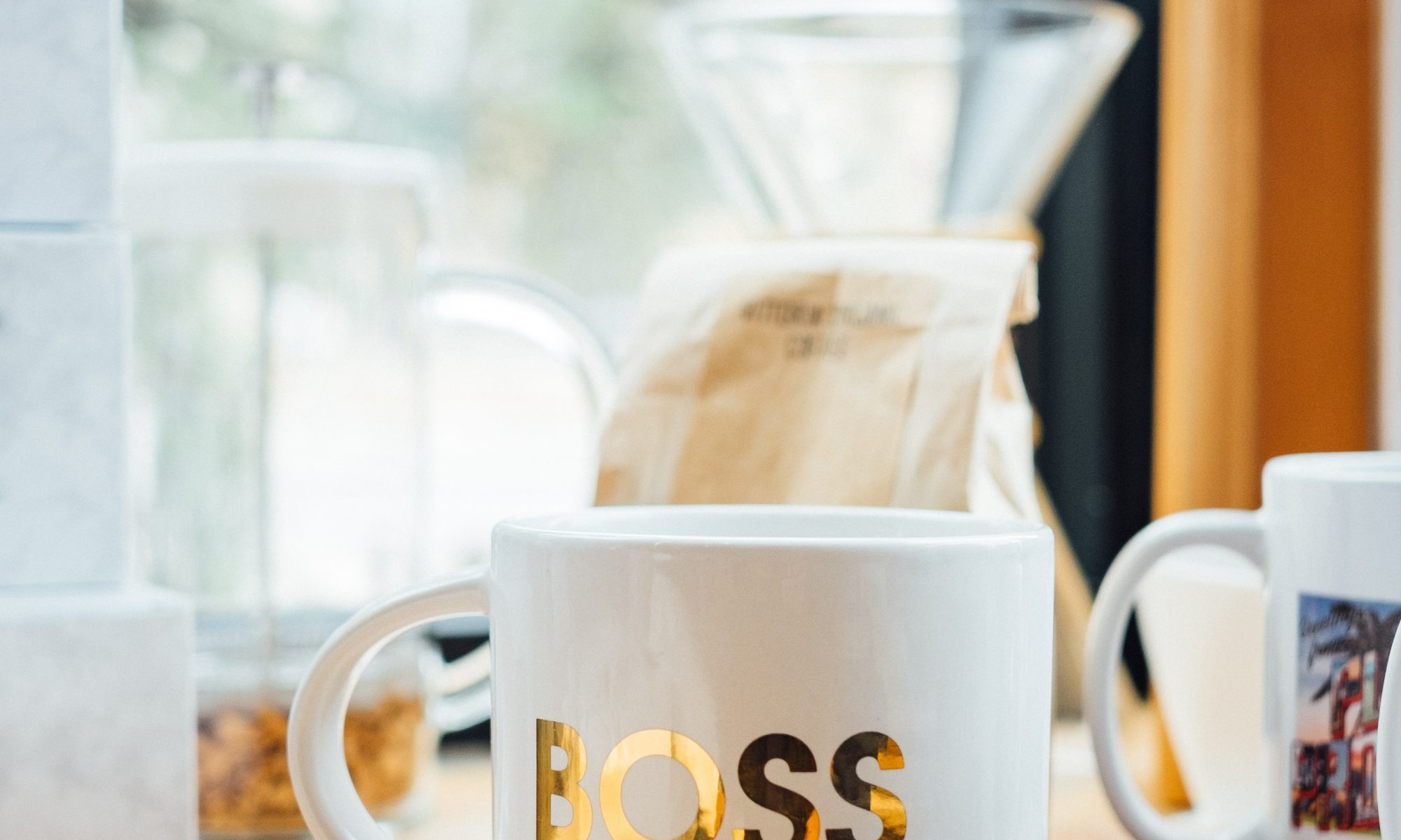 "A coffee mug with the word ""Boss"" imprinted on it"