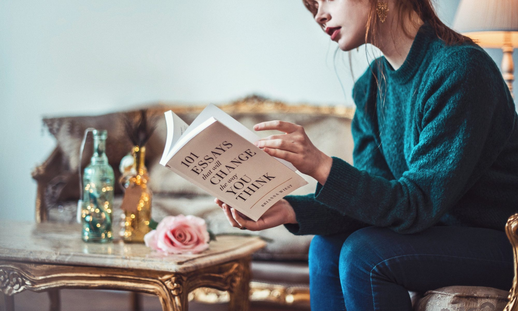 Woman reading a book about essays
